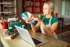 Creative Young Woman in Workshop